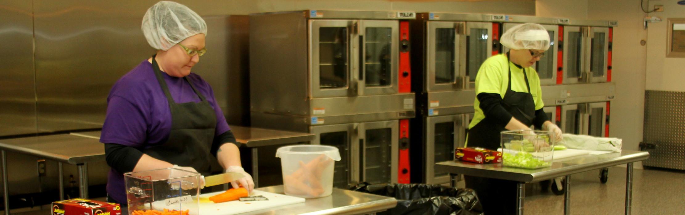 Food preparation in an industrial kitchen.