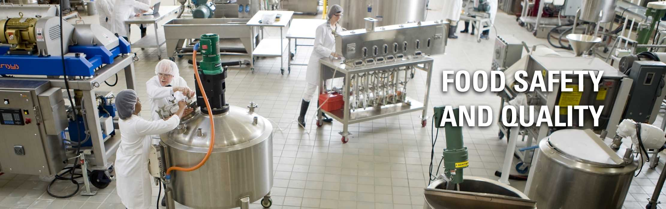Technicians working in a food processing incubator: Food Safety and Quality.