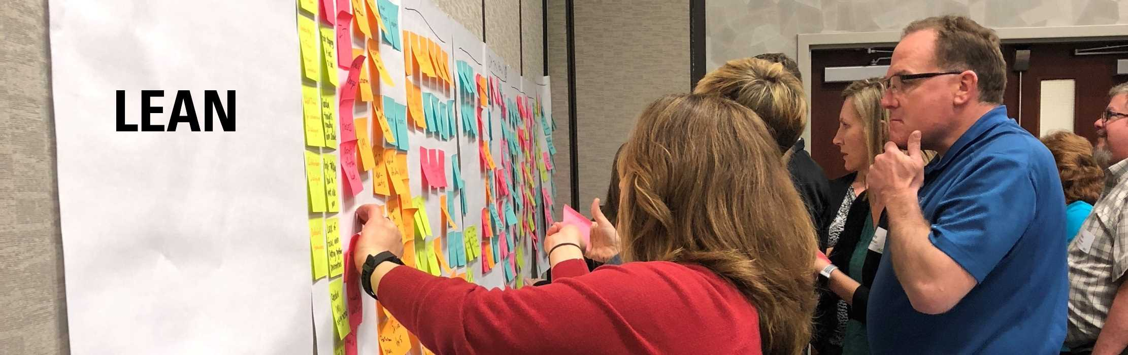 Continuous improvement experts review a value stream map at an Iowa Lean Consortium training event: Lean.