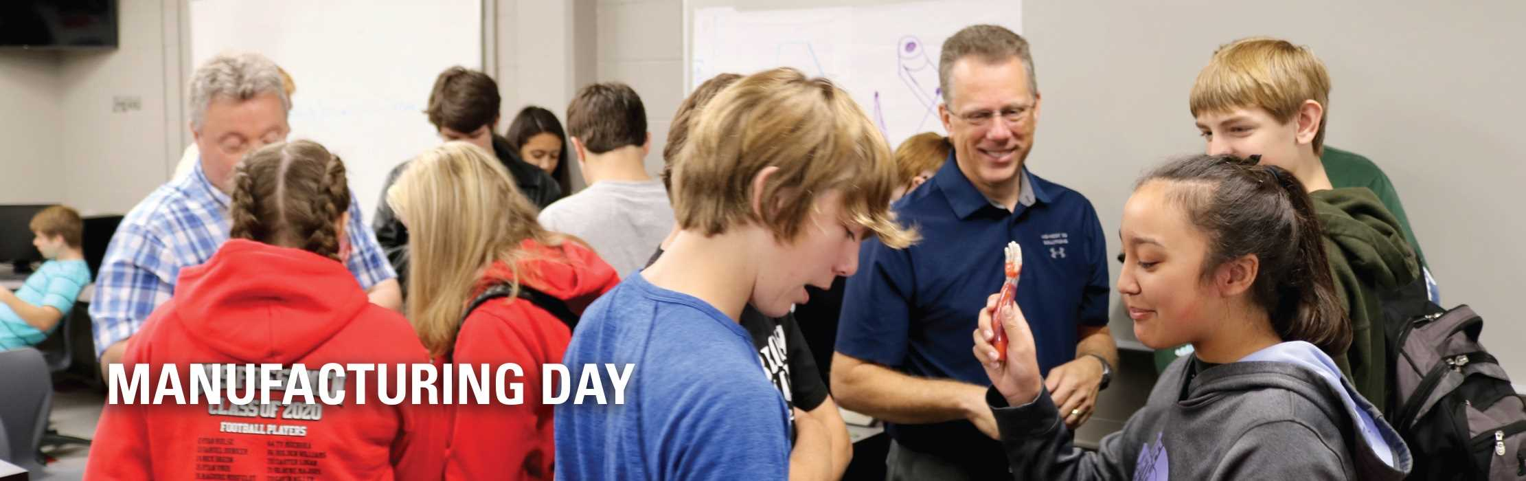 Iowa high school students interacting with faculty and industry on National Manufacturing Day.